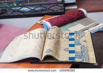 stock-photo-wallpaper-and-fabric-swatches-sample-book-165999389